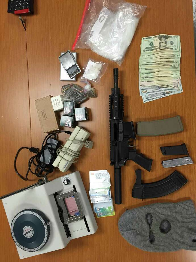 Officers who interrupted an attempted car theft in Berkeley one block south of UC Berkeley said they uncovered cash, weapons, ammunition and equipment to forge credit cards inside the home of one man they arrested.