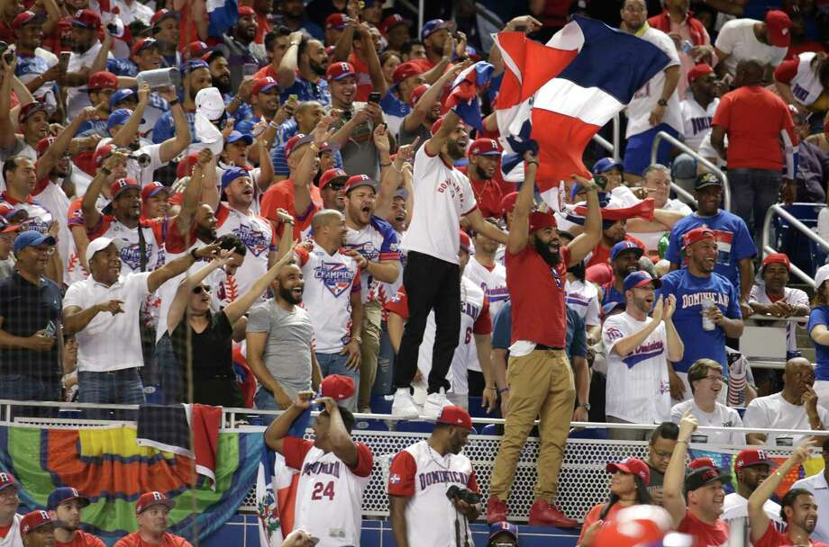 Fans cheer for the Dominican Republic during a first-round game of the World Baseball Classic against the United States, Saturday, March 11, 2017, in Miami. (AP Photo/Lynne Sladky) Photo: Lynne Sladky, STF / Copyright 2017 The Associated Press. All rights reserved.