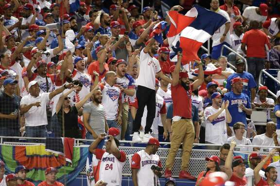 Fans cheer for the Dominican Republic during a first-round game of the World Baseball Classic against the United States, Saturday, March 11, 2017, in Miami. (AP Photo/Lynne Sladky)