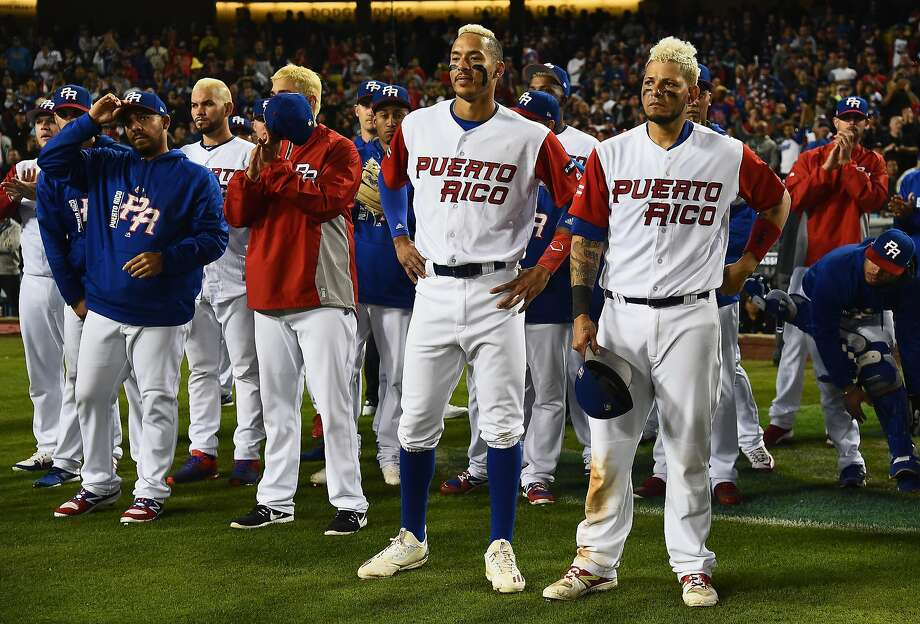 LOS ANGELES, CA - MARCH 22:  Team Puerto Rico looks on as team United States celebrates their 8-0 win during Game 3 of the Championship Round of the 2017 World Baseball Classic at Dodger Stadium on March 22, 2017 in Los Angeles, California.  (Photo by Jayne Kamin-Oncea/Getty Images) Photo: Jayne Kamin-Oncea, Getty Images