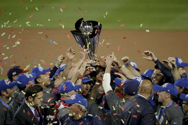 The U.S. team celebrates an 8-0 win over Puerto Rico in the final of the World Baseball Classic in Los Angeles, Wednesday, March 22, 2017. (AP Photo/Jae C. Hong)