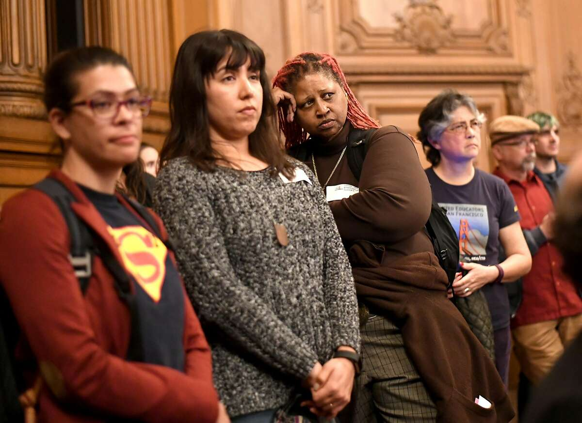 Rosa Parks Elementary School teacher Sekani Moyenda, center, waits to address the San Francisco Board of Supervisors during a hearing on affordable teacher housing on Wednesday, March 22, 2017, in San Francisco.
