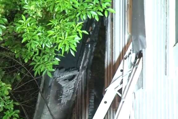 A home housing in southwest Houston housing 29 people went up in flames early Thursday morning. (Metro Video)