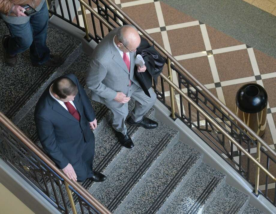 State Sen. Robert Ortt, left and his attorney, Stephen Coffey, descend a staircase in the Albany County Courthouse on Thursday. (Skip Dickstein / Times Union) Photo: Skip Dickstein / Times Union