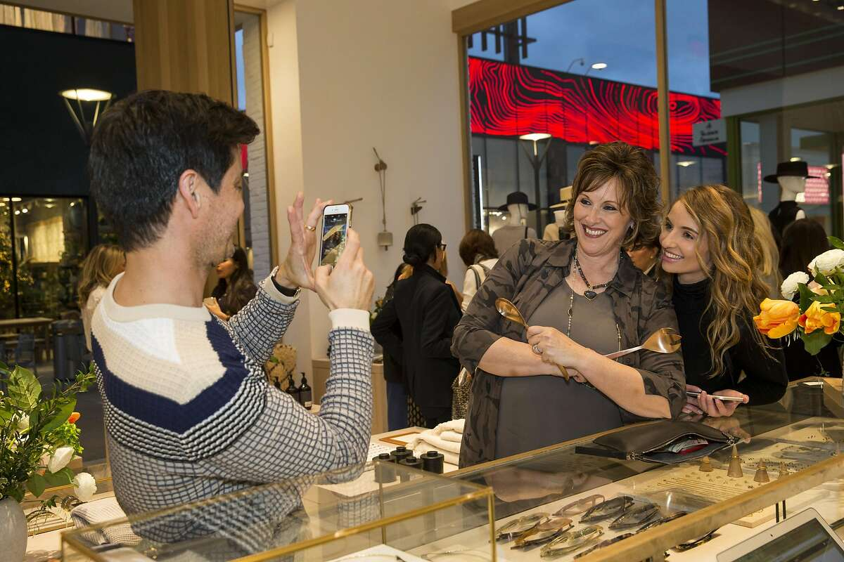 John Contreras snaps a photo for Roxanne Deblauwe and Anne Graham (left to right) during an event at the Jenni Kayne store at Stanford Shopping Center in Palo Alto, Calif., on Tuesday, March 21, 2017. The party was a benefit for the diabetes organization Beyond Type 1.