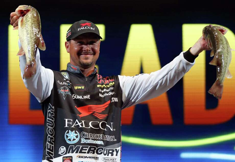 Jason Christie, from Park Hill, Okla., shows off two fish he caught on Day 2 of the Bassmaster Classic on March 5, 2016, in Tulsa, Okla. Photo: Cory Young /Associated Press / Tulsa World
