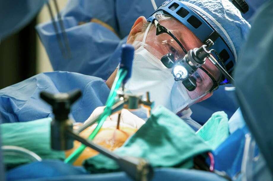 Dr, Joseph Lamelas performs heart surgery at Baylor St. Luke's Hospital on Thursday, March 2, 2017, in Houston. Lamelas is a pioneer in minimally invasive cardiac surgery. Photo: Brett Coomer, Houston Chronicle / © 2017 Houston Chronicle