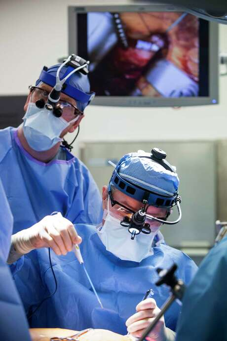 Dr, Joseph Lamelas performs heart surgery, with Dr. David Daniel looking over his shoulder, at Baylor St. Luke's Hospital on Thursday, March 2, 2017, in Houston. Lamelas is a pioneer in minimally invasive cardiac surgery. Photo: Brett Coomer, Houston Chronicle / © 2017 Houston Chronicle