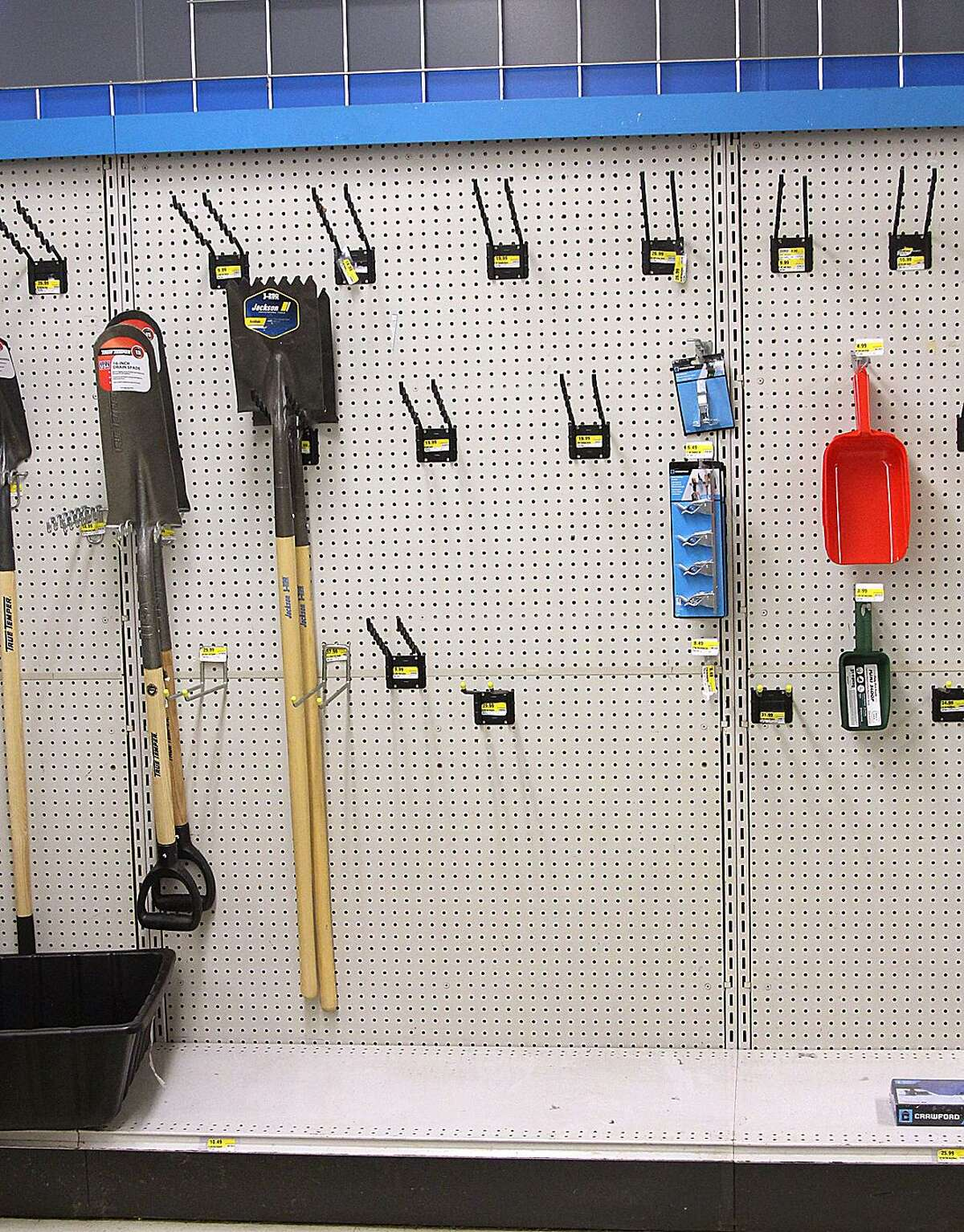 The rack of lawn and garden tools is sparcely populated at Deep Hardware on Wednesday, March 22, 2017, in Danbury, Conn., as the store is holding a closing sale