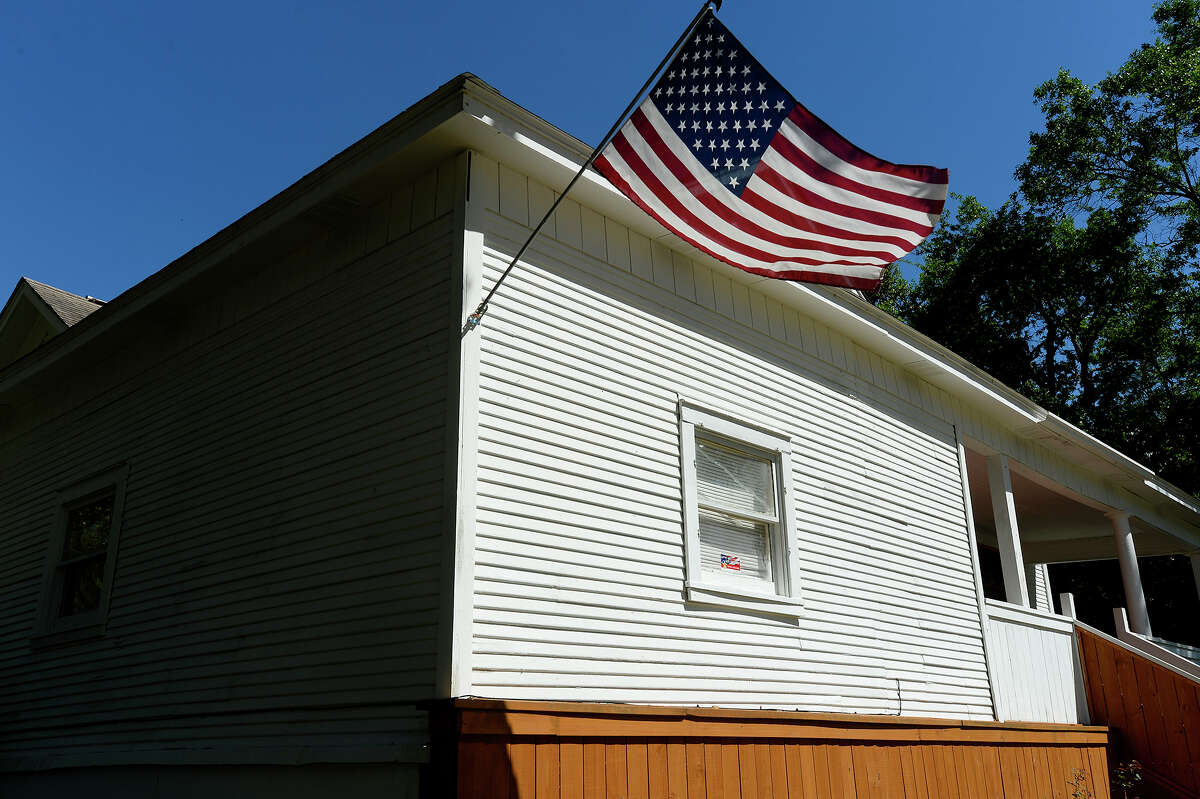 An American flag flies from the Young Americans Overseas housing complex to help veterans on Linson Street in Beaumont's north end. Photo taken Tuesday 3/21/17 Ryan Pelham/The Enterprise