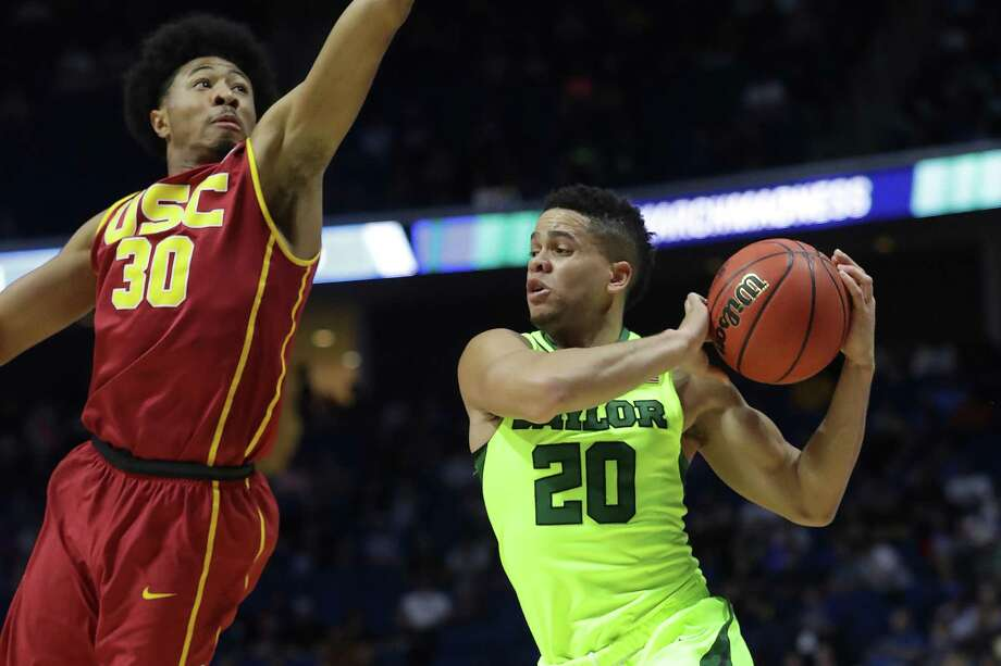 Manu Lecomte (20) of the Baylor Bears is defended by Elijah Stewart of the USC Trojans during the second round of the NCAA Tournament at BOK Center on March 19, 2017, in Tulsa, Okla. Photo: Ronald Martinez /Getty Images / 2017 Getty Images