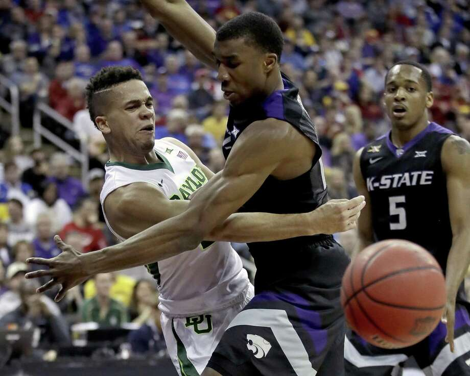 Baylor guard Manu Lecomte, left, passes around Kansas State defender Xavier Sneed in the quarterfinal round of the Big 12 tournament in Kansas City, Mo. A reader says post-season success will do nothing to mitigate the recent sexual assault scandal at Baylor University. Photo: Charlie Riedel /Associated Press / Copyright 2017 The Associated Press. All rights reserved.