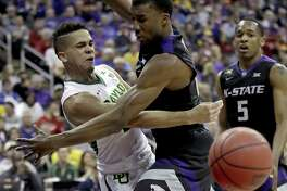 Baylor guard Manu Lecomte, left, passes around Kansas State defender Xavier Sneed in the quarterfinal round of the Big 12 tournament in Kansas City, Mo. A reader says post-season success will do nothing to mitigate the recent sexual assault scandal at Baylor University.