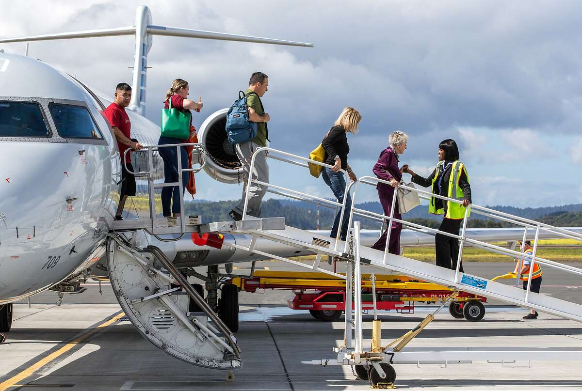 Passengers exit an American Airlines plane that arrived from Phoenix, Arizona, to the Charles M. Schulz�Sonoma County Airport on Wednesday, March 22, 2017, in Santa Rosa, Calif. The airport is undergoing a significant expansion, both in terms of space and the amount of air traffic they have coming in and out. Last month, American Airlines began a daily nonstop flight to Phoenix-Sky Harbor International Airport, marking the first direct connections from Sonoma County to a major hub east of California.