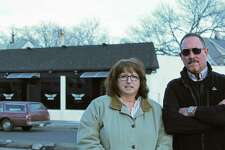 Kings Highway Neighborhood Association members Cheryl Churchill and Pete Lapak stand across the street from the Sky Hookah Lounge.
