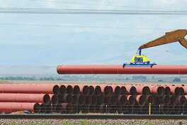 Pipe is stacked for a Kinder Morgan pipeline in 2006. The company is planning to add a 42-inch, 430-mile natural gas pipeline to run from West Texas' Permian Basin shale play to the Texas Gulf Coast.