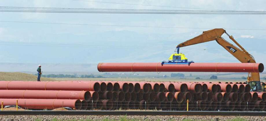 Pipe is stacked for a Kinder Morgan pipeline in 2006. The company is planning to add a 42-inch, 430-mile natural gas pipeline to run from West Texas' Permian Basin shale play to the Texas Gulf Coast. Photo: Bloomberg News /File Photo