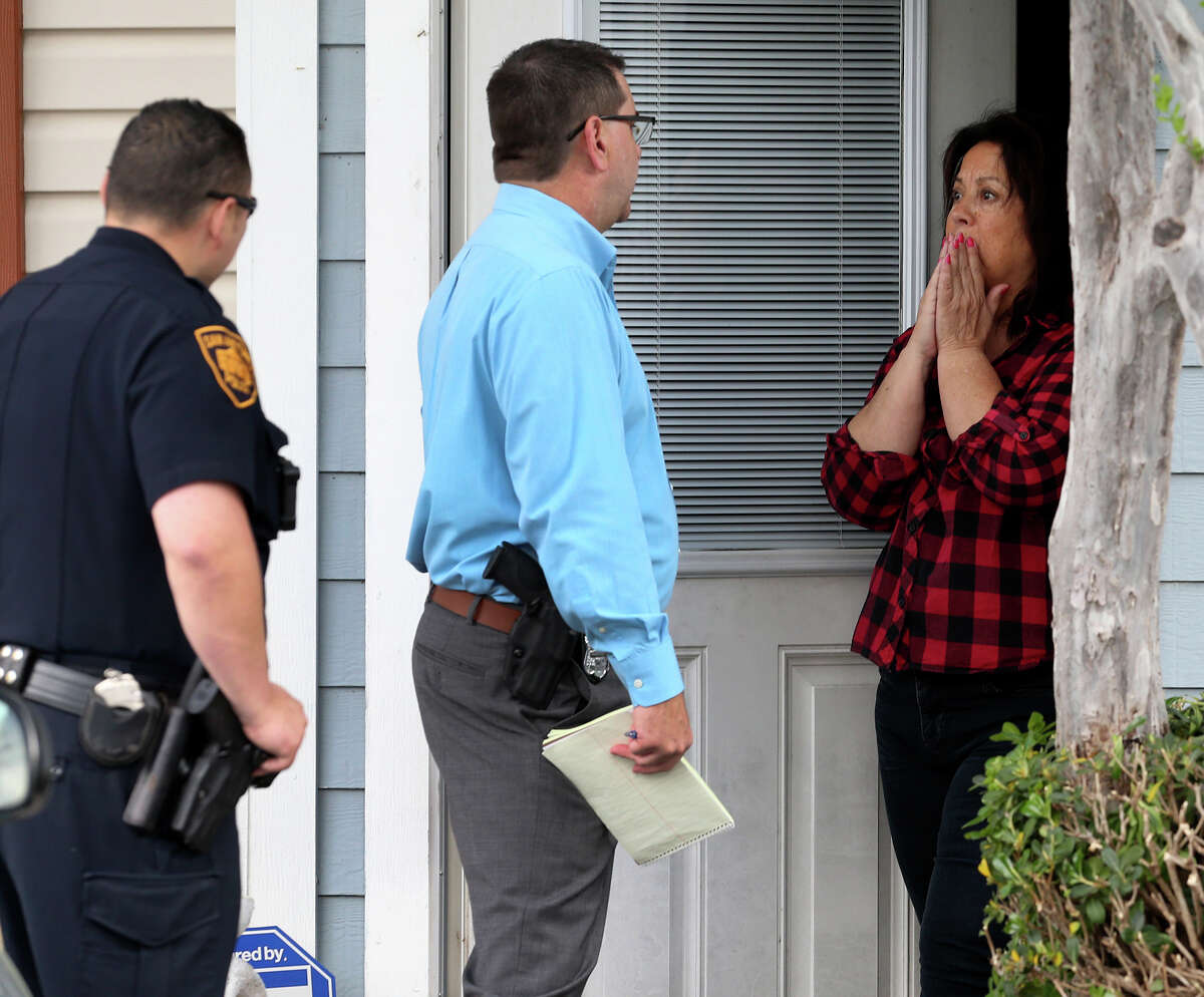 Police investigate Thursday March 23, 2017 at the scene of a double fatality on the 1800 block of Budding on San Antonio's North Side. Police Chief William McManus said a juvenile left the home to go to school and then returned to find both of his parents dead. Police received the call about 7:55 a.m. . Police said it appeared the couple was stabbed to death.