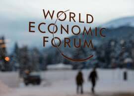 """The logo of the World Economic Forum (WEF) is seen on window pane at the Congress Center prior to the forum's annual meeting in Davos on January 18, 2016. More than 40 heads of states and governments will attend the WEF in Davos, which this year is focused on """"mastering the fourth Industrial Revolution,"""" organisers said. / AFP / FABRICE COFFRINIFABRICE COFFRINI/AFP/Getty Images"""