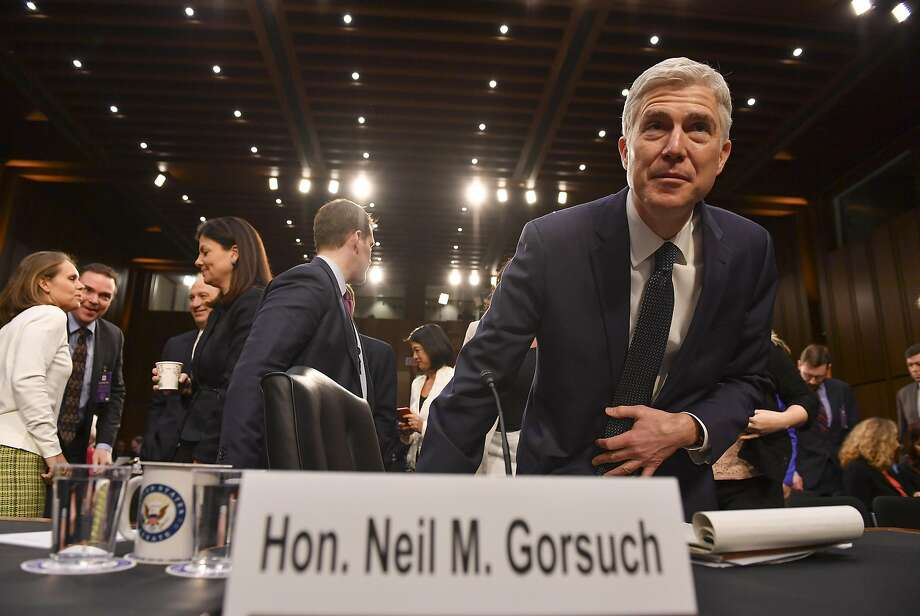 Neil Gorsuch, President Donald Trump's nominee for the Supreme Court, returns after a recess during the third day of his confirmation hearing. Senate Democrats more aggressively questioned him as Republicans appeared confident he will be confirmed. Must credit: Washington Post photo by Ricky Carioti Photo: Ricky Carioti, The Washington Post
