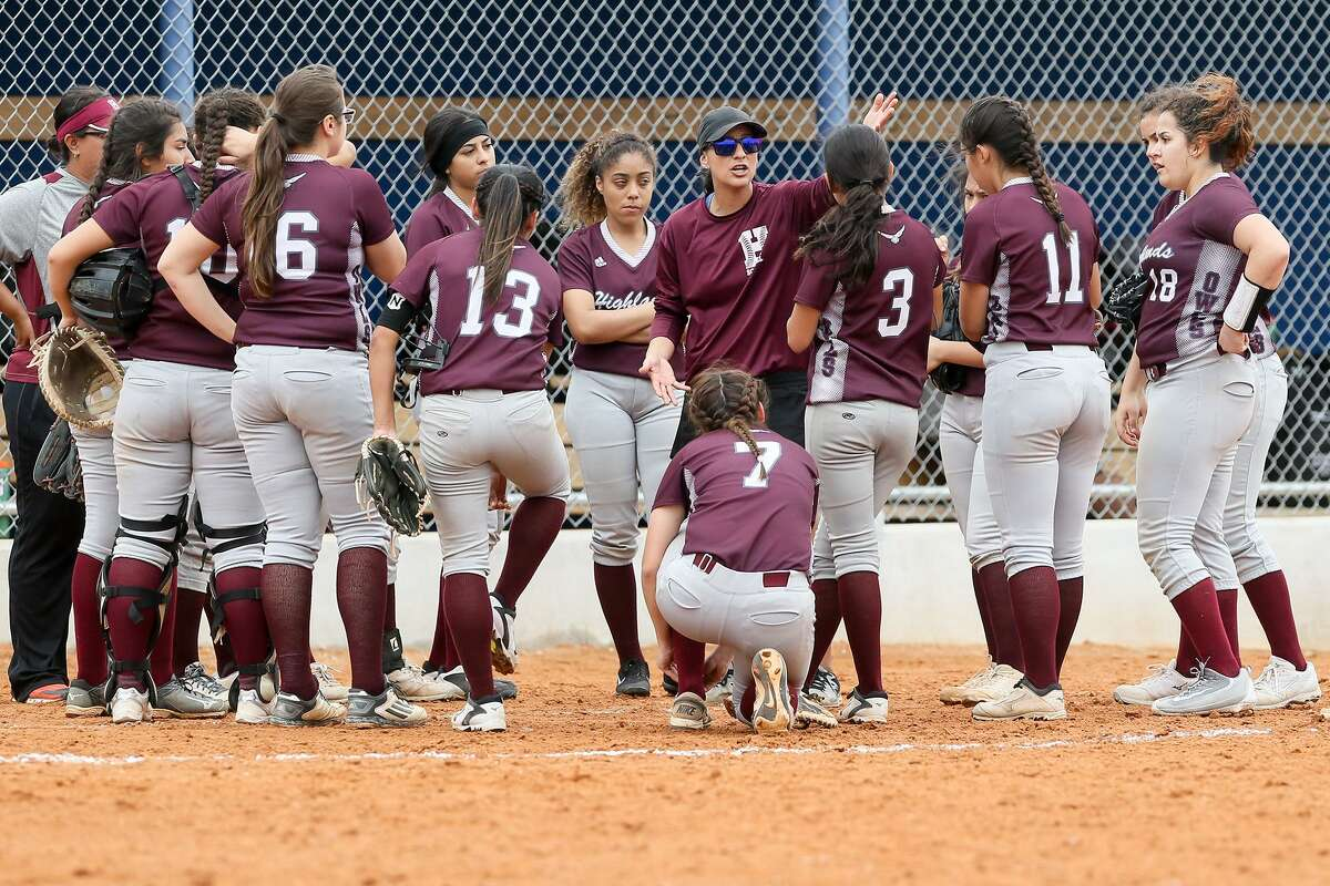 Highlands coach Monica Acuna talks to the Lady Owls between innings during their District 28-5A softball game with Memorial at the SAISD Softball Complex on March 16. Highlands beat Memorial 15-0 in three innings.