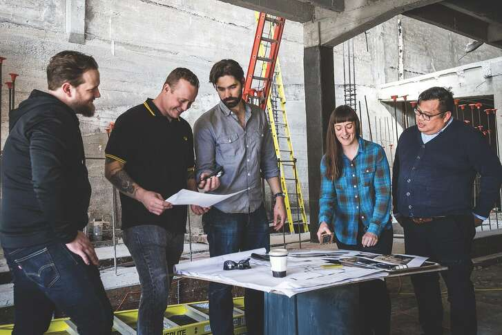 The team at Che Fico looks over plans in the ground floor Divisadero space that will become Theorita; Che Fico will be upstairs. Left to right: Ryan Fowler, David Nayfeld, Matt Brewer, Angela Pinkerton, Jon de la Cruz