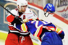 JAMES GOOLSBY/TIMES UNION-Dec. 5, 2008-L. TO R.-Albany River Rats #10-Mike Angelidis knocks the helmet off Norfolks #20-Grant Potulny, as they mix-it-up in the first period of game at the Times Union Center.