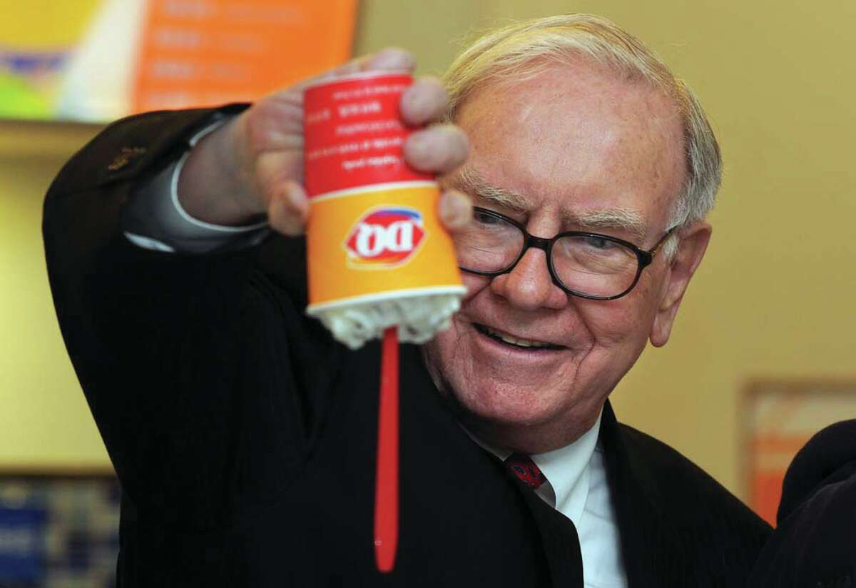 Warren Buffet with a Blizzard Treat at Dairy Queen, one of companies his Berkshire Hathaway owns.