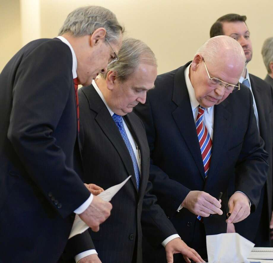 George Maziarz, center, looks on as his attoneys examine the indictment accusing him of offering a false instrument for filing. (Skip Dickstein / Times Union) Photo: Skip Dickstein / Times Union