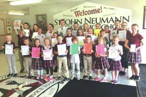 Every  year the students at St. John Neumann Catholic School participate in the Young Author's program.    This program is open to all students from Kindergarten through 8th grade and is designed to encourage and improve their writing abilities.    The students are given    creative freedom to write a book of whatever length they choose.    Some students even included illustrations to go along with their stories. This year SJN had an impressive number of students    that submitted their books and showed off their creative talents.    The top three stories from each class were selected and announced at the school.    From those classroom winners, five students were selected to take their books to the Young Author's Contest     in April and represent our school.