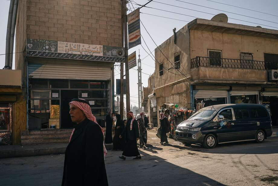 Local residents walk the streets of Tal Abyad, some 100 miles from the city of Raqqa. The U.S. and its allies are planning an assault of Raqqa, the Islamic State's self-declared capital in Syria. Photo: Alice Martins, For The Washington Post