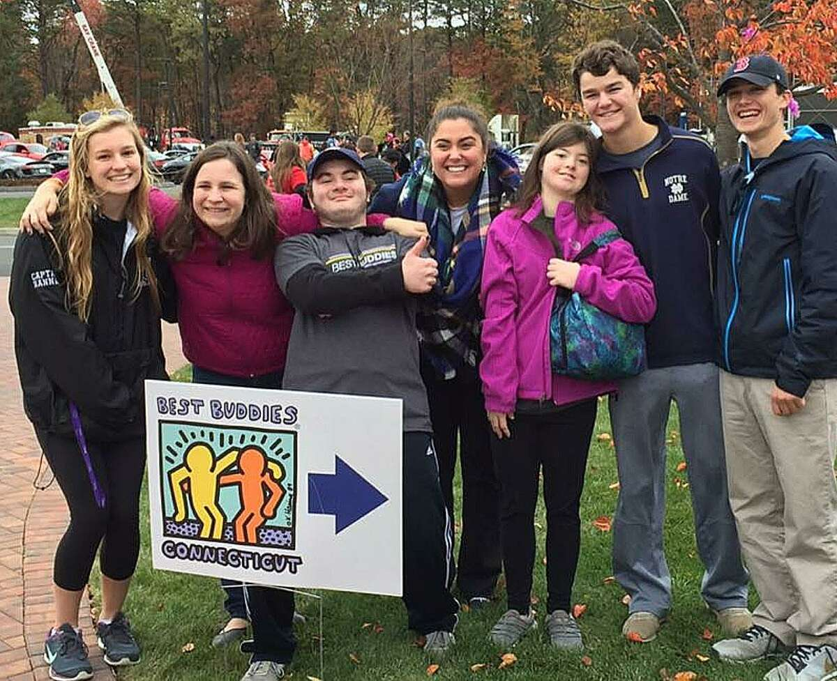 Speech-language pathologist Libby Kennedy, part of Fairfield Ludlowe High School's special education department, (pictured center) with students at the Best Buddies walk in November. Kennedy worked to bring Best Buddies to the high school this school year.