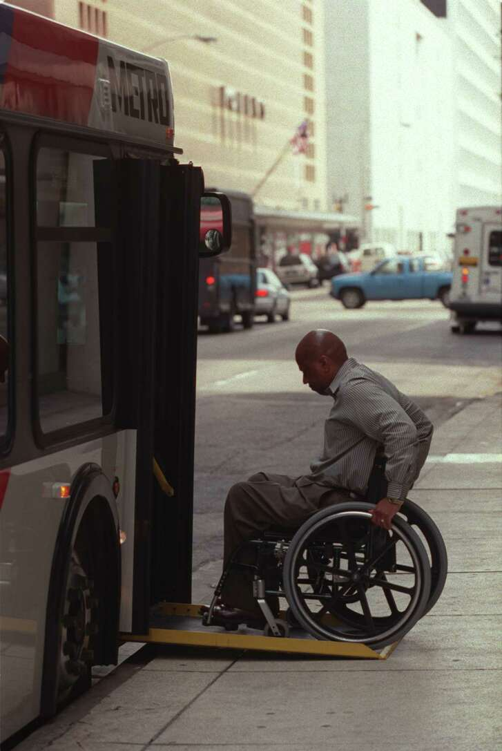 CONTACT FILED:  METROPOLITAN TRANSIT AUTHORITY-HOUSTON-METROLIFT  Auturo Jackson (CQ) manager of Metrolift services, demonstrates how the lift on this wheelchair accessible bus works outside Metro headquarters in the 1200 block of Milam in Houston Friday April 27, 2001. This is for a little story for Saturday's metro section about Metro's bus fleet now being 100 percent wheelchair-accessible.  HOUCHRON CAPTION (04/28/2001):  Art Jackson, manager of the MetroLift program, demonstrates how a wheelchair is loaded onto a bus Friday.  Metro's bus fleet now is 100 percent wheelchair accessible.