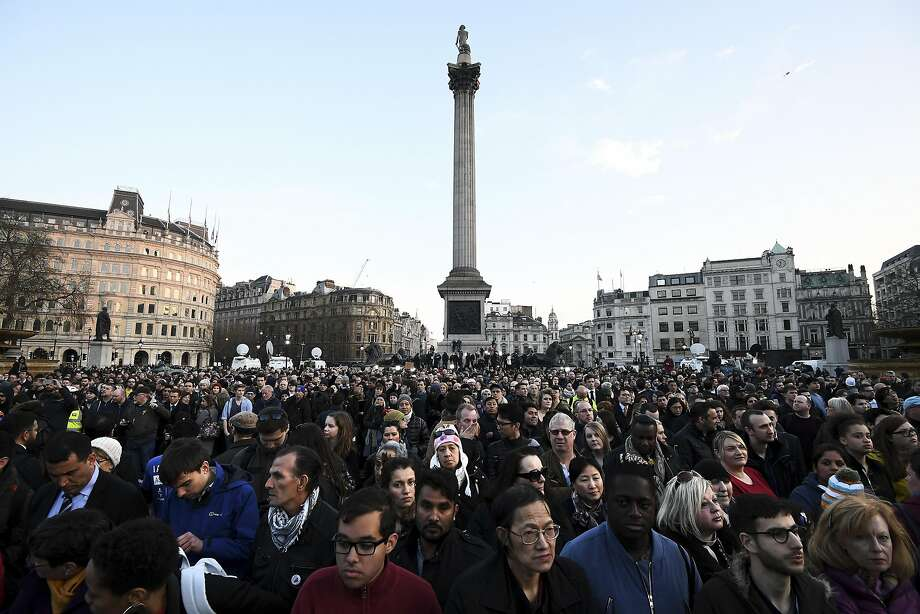 People gather ahead of a candlelit vigil at Trafalgar Square to pay tribute to victims of the terror attack. Photo: Carl Court, Getty Images