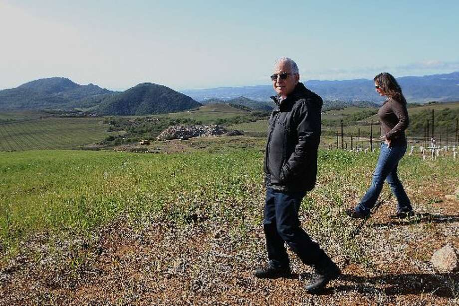 Founder Dr. Jan Krupp and former viticulturist Amy Warnock (Gabrielle Shaffer is the current viticulturist), showing where they will be planting more vines at Stagecoach Vineyard in 2012.