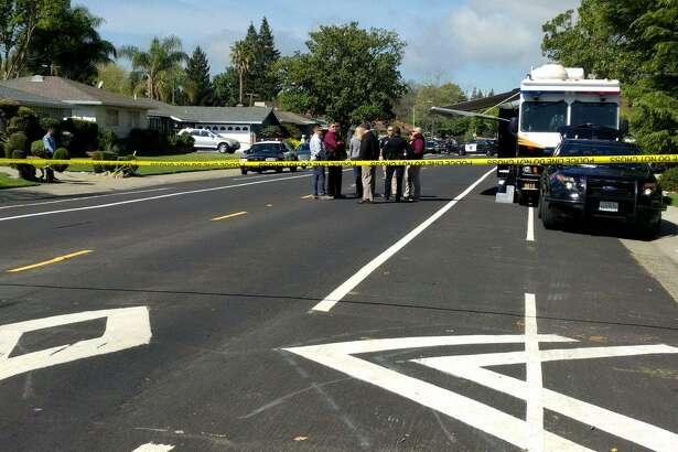 Sacramento police investigate a quadruple killing inside a home on 35th Avenue. A suspect in the killings was arreted in San Francisco, officials said.