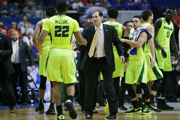 TULSA, OK - MARCH 19: Head coach Scott Drew speaks with King McClure #22 of the Baylor Bears against the USC Trojans during the second round of the 2017 NCAA Men's Basketball Tournament at BOK Center on March 19, 2017 in Tulsa, Oklahoma.  (Photo by Ronald Martinez/Getty Images)