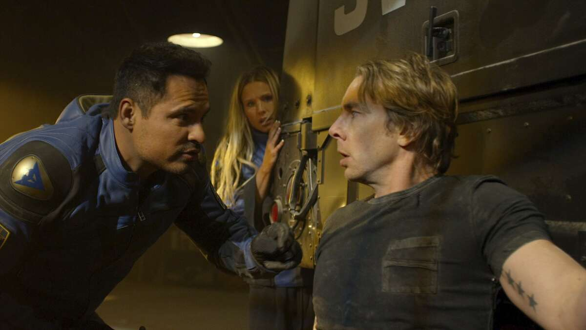 This image released by Warner Bros. Pictures shows Michael Pena, from left, Kristen Bell and Dax Shepard in a scene from,