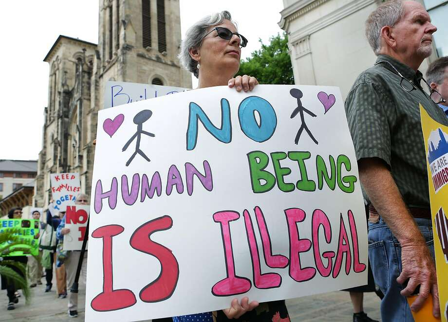 Maggie Meigs carries a sign as she joins The Missionary Catechists of Divine Providence during a prayer rally and silent march on Tuesday, March 21, 2017, in front of San Fernando Cathedral. Seventy five gathered to show their support and to promote a spirit of hospitality to immigrants and express solidarity with immigrants. Photo: Bob Owen, San Antonio Express-News
