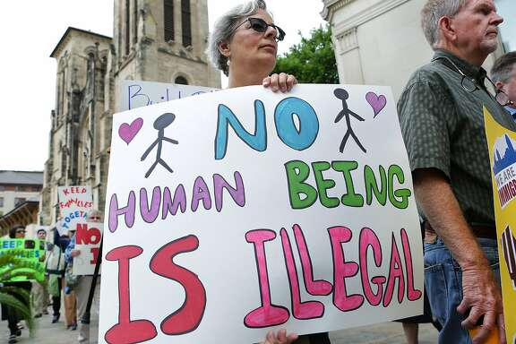 Maggie Meigs carries a sign as she joins The Missionary Catechists of Divine Providence during a prayer rally and silent march on Tuesday, March 21, 2017, in front of San Fernando Cathedral. Seventy five gathered to show their support and to promote a spirit of hospitality to immigrants and express solidarity with immigrants.
