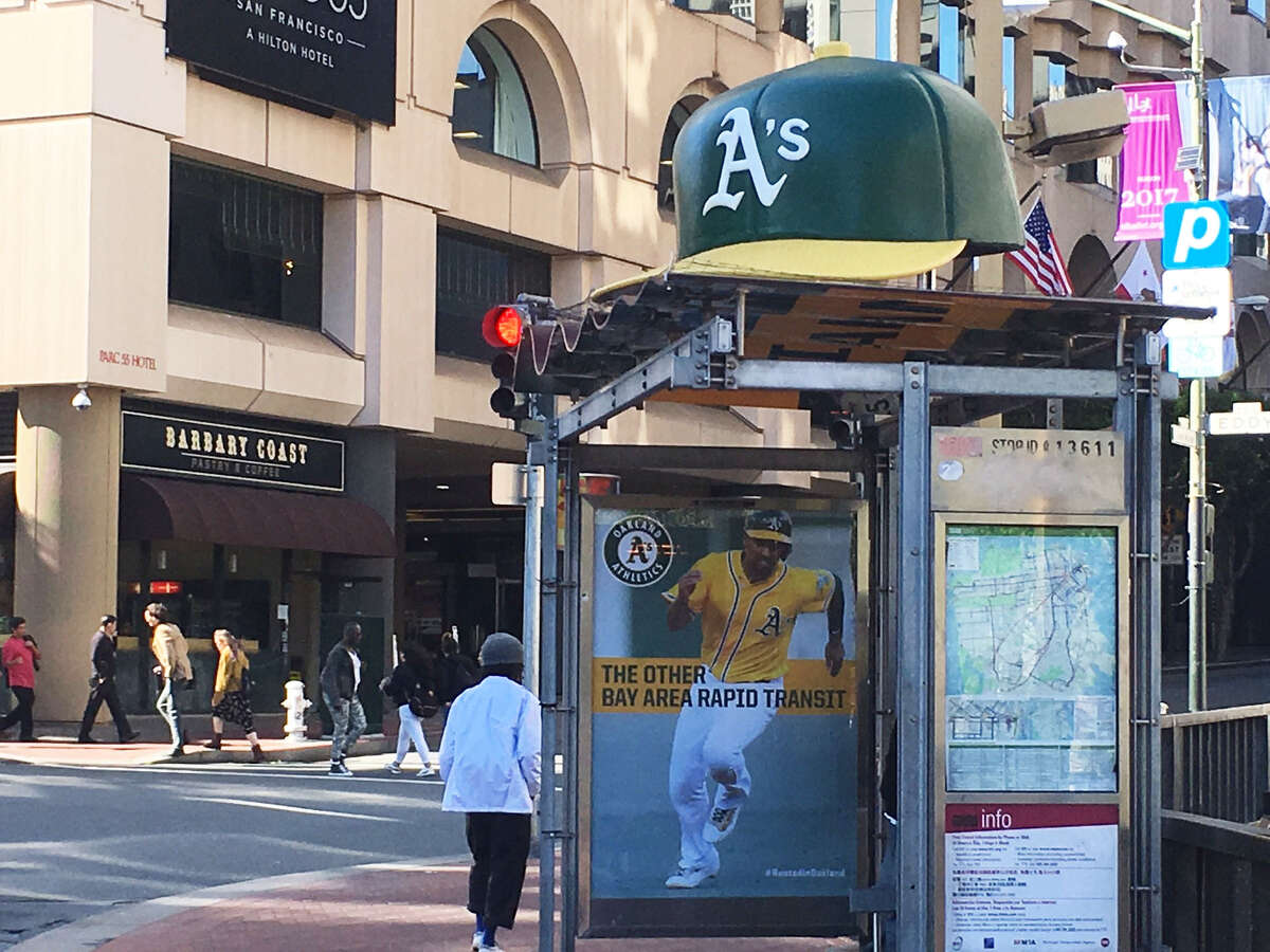 The Rooted In Oakland campaign has spread to San Francisco, where a cap now sits atop this Muni stop.