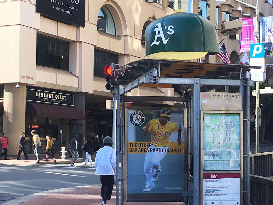 The Rooted In Oakland campaign has spread to San Francisco, where a cap now sits atop this Muni stop. Photo: Bill Disbrow