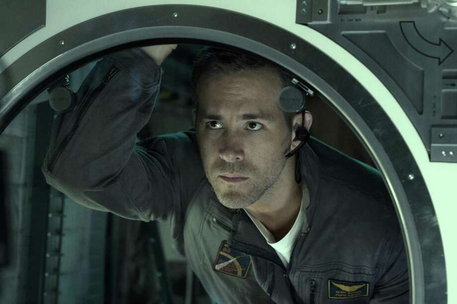 Something on the other side of the glass is thinking Ryan Reynolds might make a good snack. Photo: Columbia Pictures / © 2016 CTMG, Inc. All Rights Reserved. **ALL IMAGES ARE PROPERTY OF SONY PICTURES ENTERTAINMENT INC. FOR PROMOTIONAL USE ONLY. S