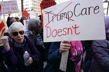 Protestors take part in a demonstration outdide of the Trump Hotel on health care on March 23, 2017 in Washington, DC. US President Donald Trump held last-minute negotiations with fellow Republicans to avoid a humiliating defeat Thursday in his biggest legislative test to date, as lawmakers vote on an Obamacare replacement plan which conservatives threaten to sink. / AFP PHOTO / MANDEL NGANMANDEL NGAN/AFP/Getty Images