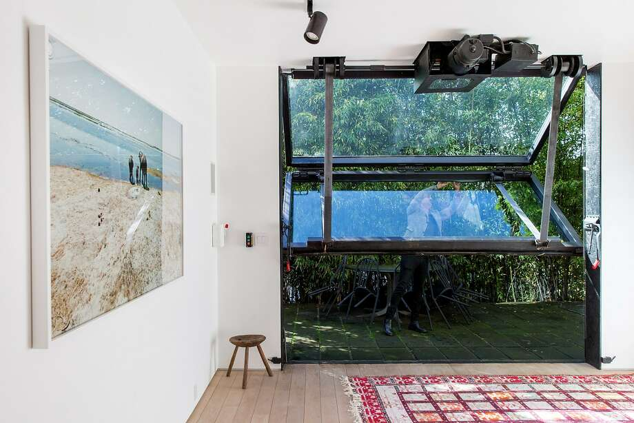 Sliding industrial doors offer access to a secluded patio. Photo: Santiago Mejia, The Chronicle