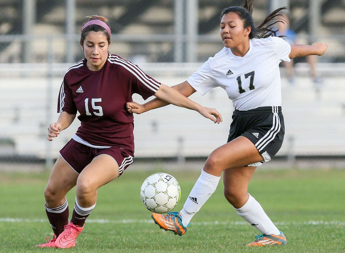 Highlands' Catalina Canizalez (left) fights for the ball with Edison's Ana Ruiz during their District 28-5A girls soccer game at the SAISD Sports Complex on Tuesday, Feb. 7, 2017. Canizalez scored two goals to help Highlands remain undefeated in district play with a 4-0 victory over Edison. MARVIN PFEIFFER/ mpfeiffer@express-news.net