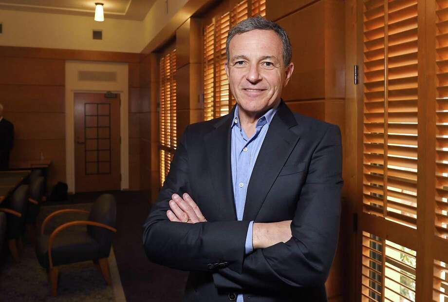 Bob Iger, Walt Disney Co.'s chief executive officer for more than a decade, agreed to a contract extension that will keep him atop the world's largest entertainment company until July 2019. Photo: Associated Press /File Photo / Copyright 2017 The Associated Press. All rights reserved.