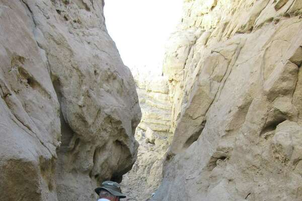 Hike slot canyons as part of a Red Jeep tour or on your own in the Coachella Valley.