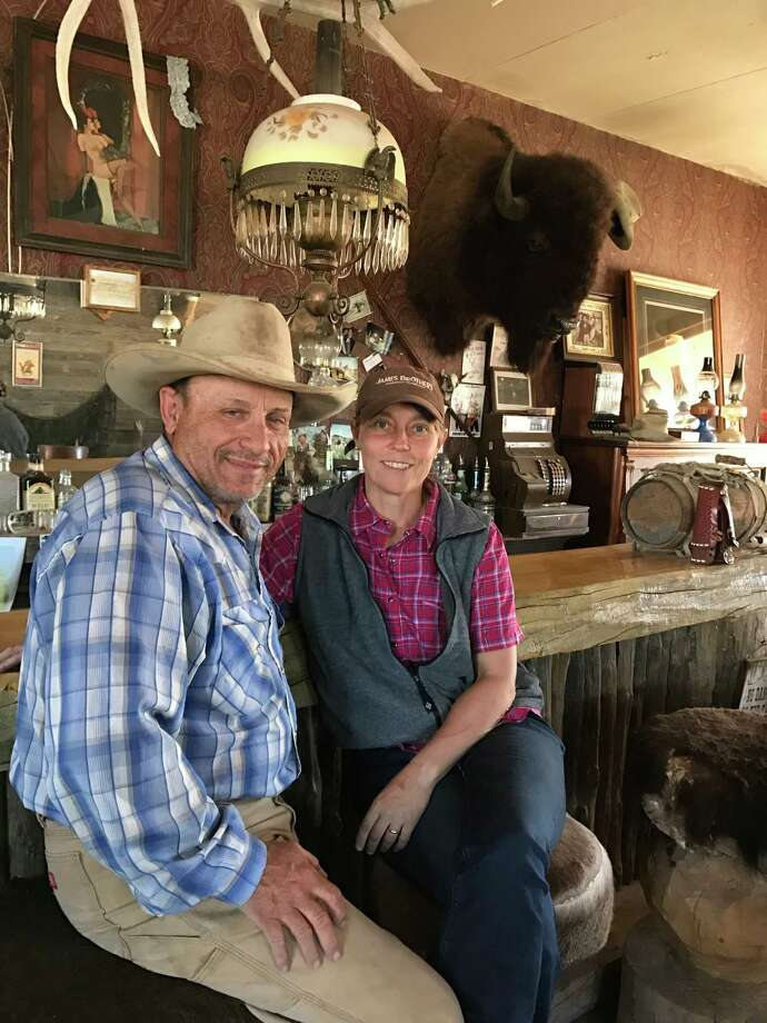 Lipscomb County ranchers Lance and Tanja Bussard, at their Alamo Saloon in Lipsomb, were among those who lost cattle in the fire. Photo: Joe Holley