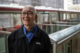 Jayme Gustilo, 27-year veteran of Seattle's Monorail, poses for a portrait at the Westlake Station on Wednesday, March 23, 2017.